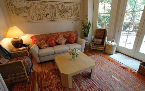 Colorful pillows, throws, and a rug from India enliven the tv room.