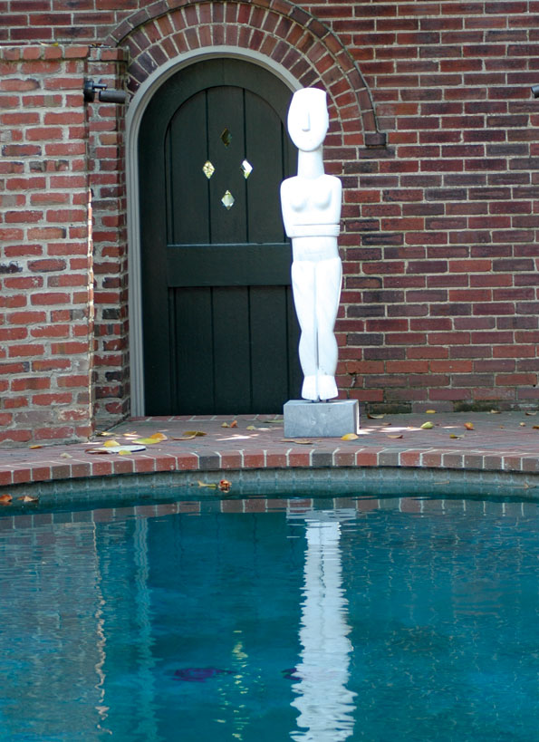 A poolside statue.