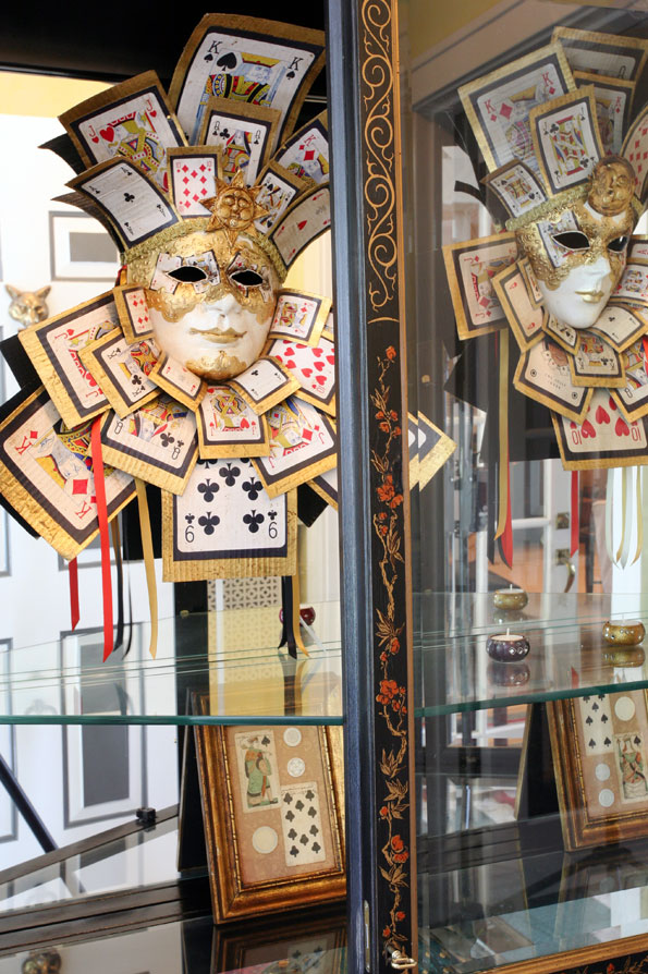Displayed in the foyer, a Venetian mask set with playing cards symbolizes Nuschese's roots in Italy and Las Vegas.
