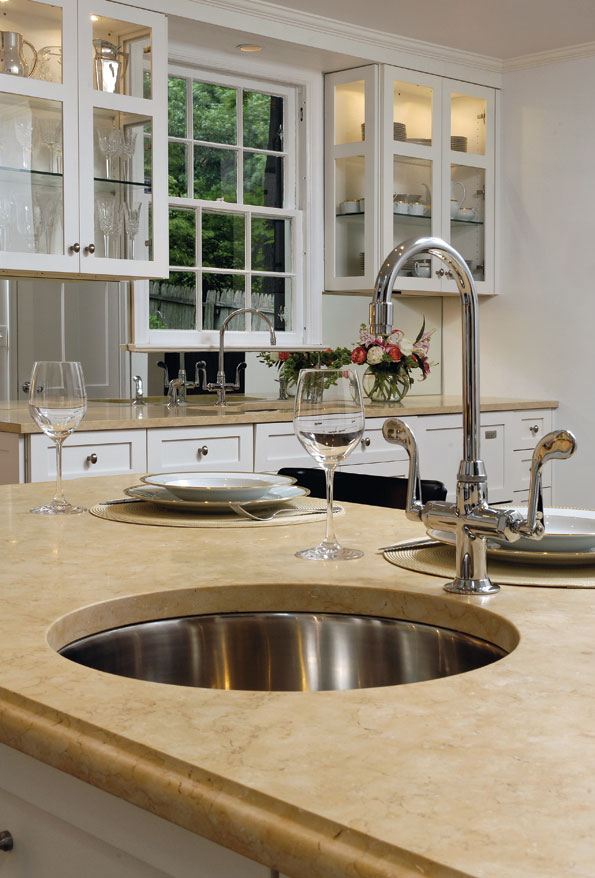 Chef Geoff's limestone-topped kitchen island incorporates its own stainless-steel prep sink.  Another sink across the room is used for washing dishes.