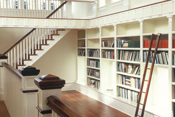 Dreyfuss and Ours restored this clerestory library.  An arched window is set into a triangular pediment, showing the architect's attention to spatial relationships. A sunken reading room provides a comfortable nook for solitary perusal of walls worth of bookshelves.
