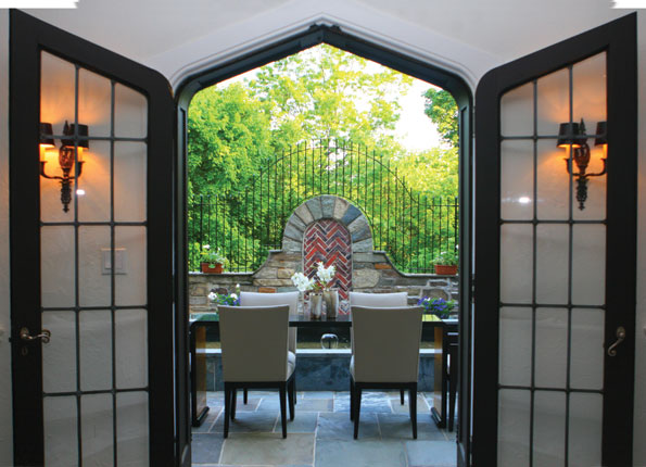 Romanesque decorative brickwork is cleverly employed to create a focal point for the garden terrace.