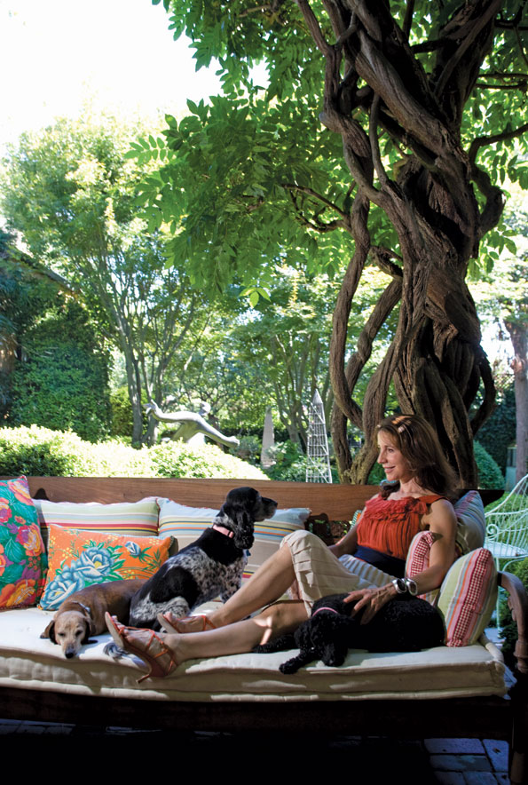Irene Danilovich lounges on her terrace with her beloved dogs: Gabriel the dachshund, Holly the cocker spaniel and Aphrodite the French poodle.