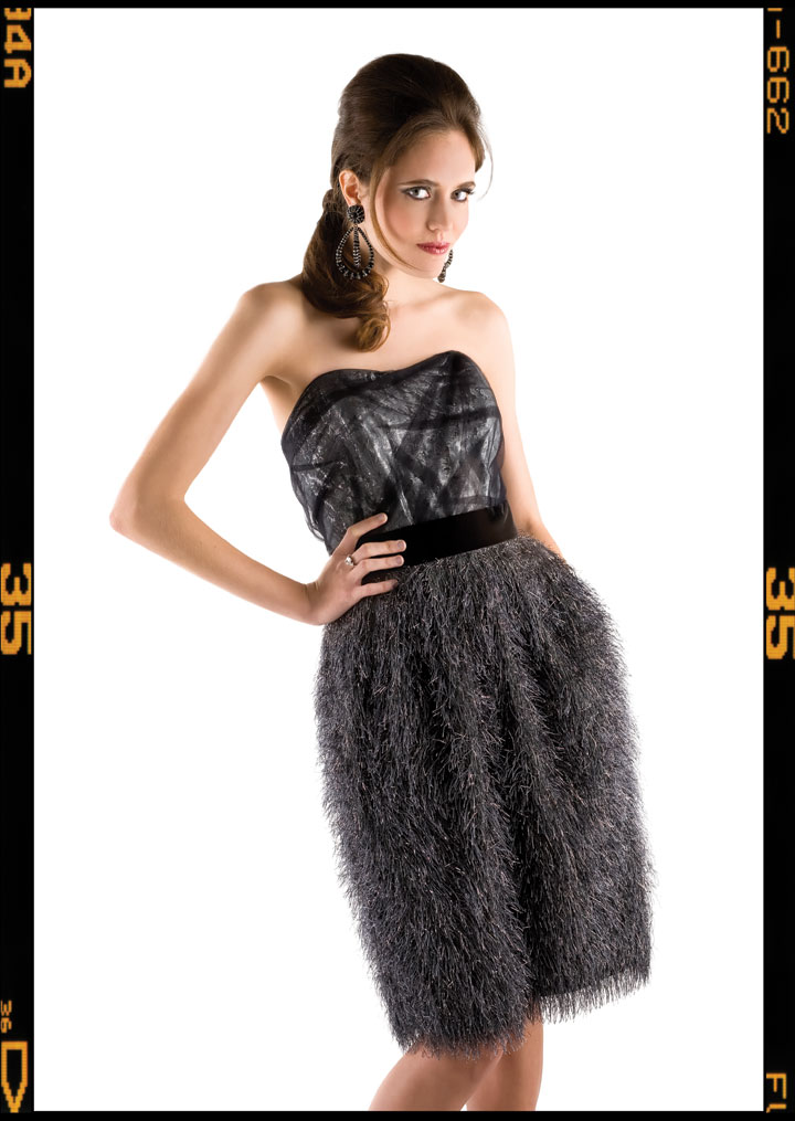 BILL BLASS silver tulle dress with black velvet waist embellishment ($3,250); Saks Jandel, 5514 Wisconsin Ave., Chevy Chase, Md., 301-652-2250. KEITH LIPERT GALLERY lolita crystal earrings ($475); Keith Lipert Gallery, 2922 M St. NW, 202-965-9736. TIFFANY & CO. platinum diamond oval with pear shaped diamonds ($137,000); Tiffany & Co., 8045 Leesburg Pike, Vienna, Va., 703-893-7700.