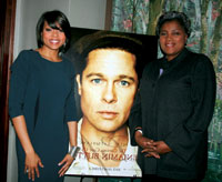 Actress Taraji P. Henson poses with Donna Brazile and a poster of her co-star Brad Pitt at a pre-pre Oscar party at Arcadia.