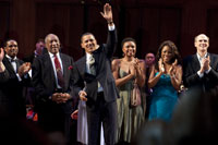 "President Barack Obama leads the cast in singing ""Happy Birthday"" to Sen. Kennedy. From left: Bill Cosby, Lizz Wright, Denyce Graves, and James Taylor."