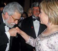 Portuguese Ambassador João de Vallera plants a deft kiss upon the hand of Hillary Rodham Clinton at the Eastern Inaugural ball at Union Station.
