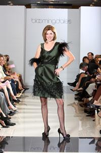 Maureen Berk, Women's Committee member, in a green silk wool dress by Lela Rose