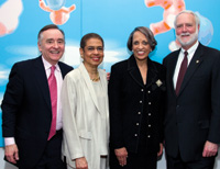 Timothy Bork, D.C. Delegate Eleanor Holmes Norton, Johnnetta Betsch Cole, and Smithsonian Secretary G. Wayne Clough at a dinner hosted by Timothy and Shigeko Bork for the board of the National Museum of African Art . (Photo by Glenn Virgin)