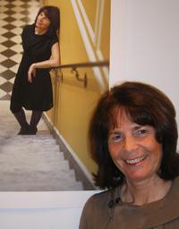 Finola Bruton, wife of the European Union's ambassador, poses near her portrait taken by Washington-based photographer Abby Greenwalt