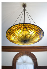 This Tiffany chandelier hangs in the dining room at the Twin Oaks estate and was part of the completed building's original furnishings in 1888