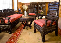 This set of intricately carved rosewood furniture was believed to have been sent by the Empress Dowager of China to the 1904 World's Fair in St. Louis before arriving at Twin Oaks