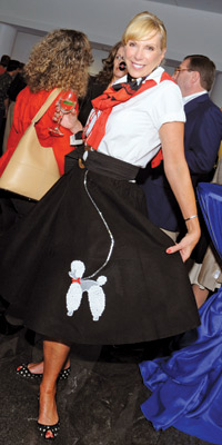Barbara McDuffie shows off one of the era-perfect poodle skirts seen in the audience at the Lombardi Cancer Center's Doo Wop Concert at the Warner Theatre.