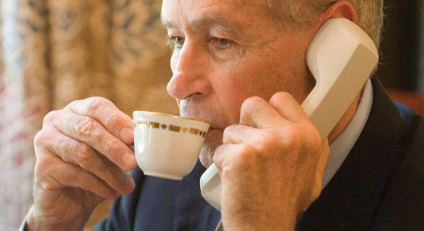 Ambassador Castellaneta enjoys an espresso while attending to business in his den.