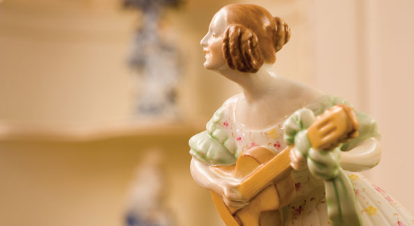A dainty figurine represents the home's impressive collection of German and Hungarian porcelains.