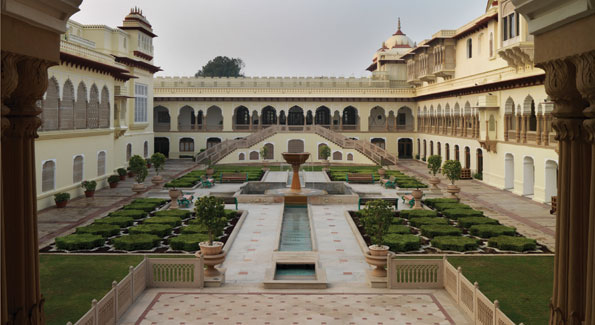 The gardens at Rambagh Palace Hotel in the capital city of Rajasthan, Jaipur. The hotel served as the home of the royal family of Jaipur until 1957.