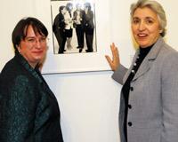 Kim Gandy and Eleanor Smeal beside an Avedon portrait of Eleanor