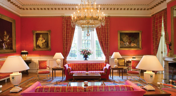 """The red """"grand salon,"""" one of the masterpieces of the residence, boasts a painting by Bonnard."""