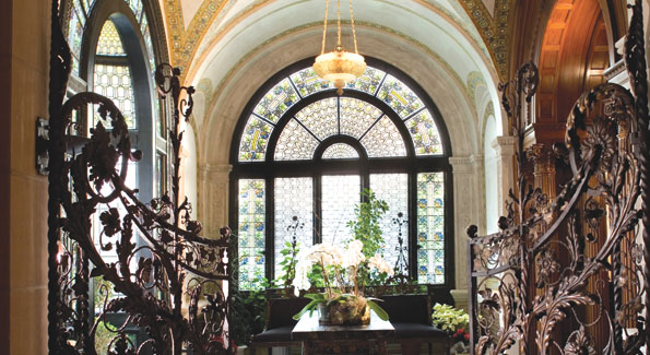 The conservatory's signature stained-glass windows, colorful mosaic ceilings, elaborate wrought bronze gate and Art Nouveaux furniture make it an ideal venue for small scale entertaining.
