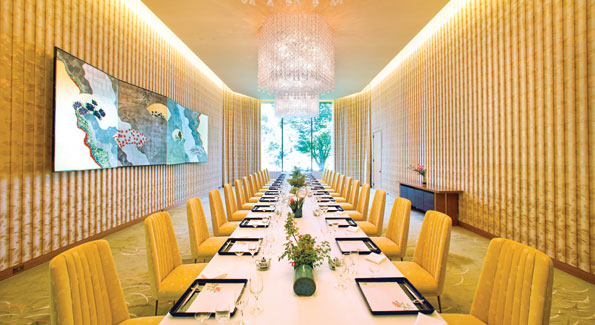 """The highlight of the main dining room, which can seat up to 60 guests, a screen painting by a well-known Japanese artist Matazo Kayama entitled """"Four Seasons."""" Residence architect Isoya Yoshida mandated that each room have only one piece of art."""