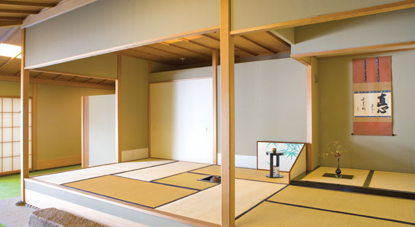 "Inside the embassy's tea house where Mrs. Kato holds traditional tea ceremonies several times a year.  The straw ""tatami"" mats, the hanging scroll and the minimalist ""ikebana"" flower arrangement are common trademarks of Japanese tea rooms."