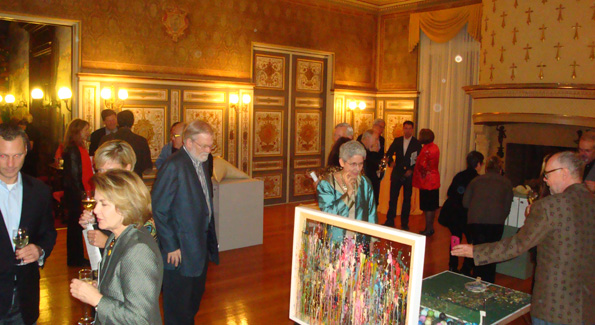 Guests perusing the artworks for sale. Photograph by Alannah Wells