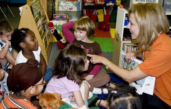 Katherine Bradley reading to children in the Jump Start program.