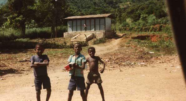 Haitian Children Outside a Latrine Built by James Hess