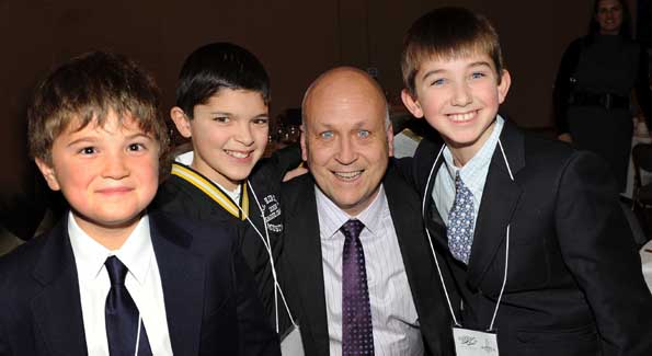 Cal Ripken, Jr. with three of his younger fans