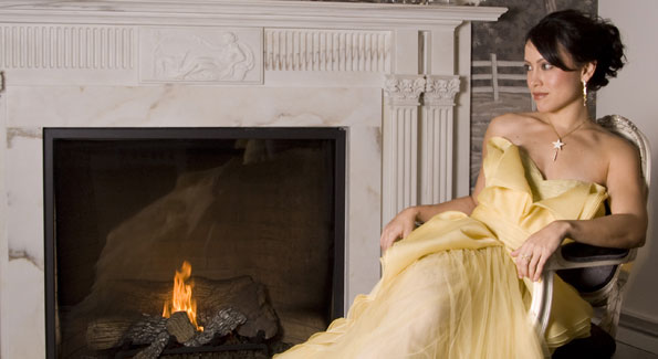 "Anna Soellner is vice president for communications at the progressive think tank, the Center for American Progress. She is wearing a J. Mendel daffodil yellow silk organza gown ($6,280); Saks Jandel, 5510 Wisconsin Avenue, Chevy Chase, Md., 301-652-2250. Mona Taner 18kt gold triple strand necklace ($550) with 18kt Mini Bail with 0.07 ct diamonds ($825), 18kt gold ""Rock Star"" pendant with 2.00ct diamonds ($10,065), and 18kt ""Tie"" pendant with 0.50ct diamonds ($3,190); 18kt gold ""Sprinkle"" hoop earrings with 1.25ct diamonds ($6,380) and 18kt gold ""Sprinkle"" pendants with 1.50 ct diamonds ($10,120); and 18kt gold ""Passion"" ring with 1.60ct diamonds ($6,490); Mona Taner Boutique, inside Mervis Diamond Importers, 5480 Wisconsin Ave., Chevy Chase, Md., 301-215-9500, www.monataner.com. Valentino black patent leather peep toe heels with large bow detail ($745); Neiman Marcus, 5300 Wisconsin Ave. NW, 202-966-9700, www.neimanmarcus.com., Photo by Jodi King"