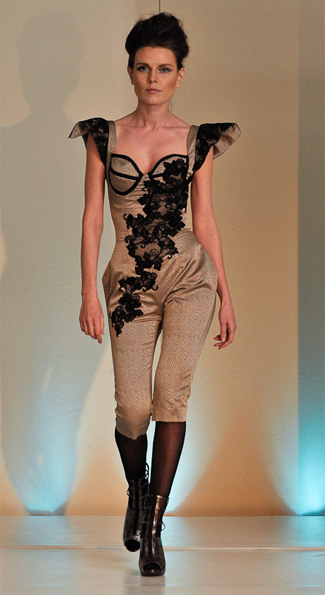 model wears camel body suit with lace design by Lavill