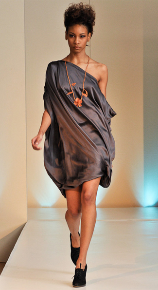 Designed by TATA, a sexy silk off the shoulder dress graced the runway.