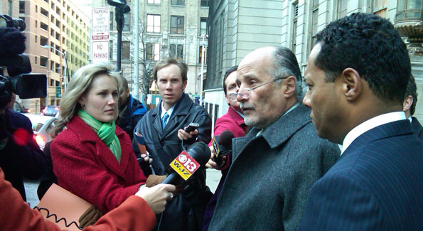 Flanked by his son and firm Managing Partner, William Murphy St. addresses the media.