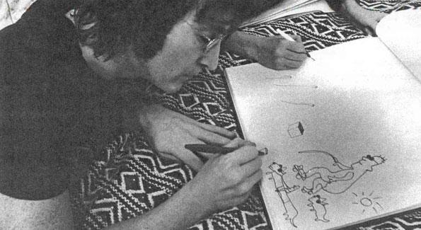 John Lennon sketching.