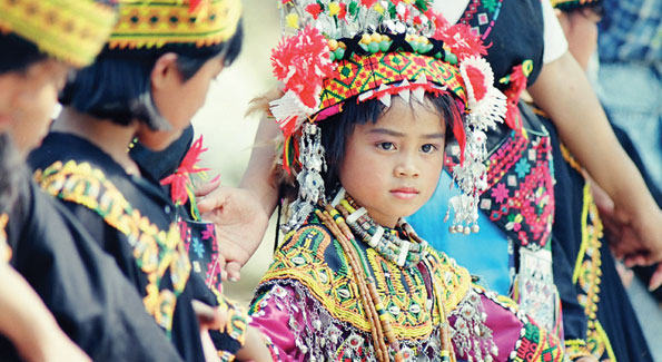 A child from one of Taiwan's 14 indigenous tribes wears traditional dress.