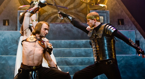 Marc Antony (Ben Cunis) dmoinates an Egyptian temple/throne room scene with the help of swordsmen Scott Brown (left) and Matthew Ward (right)