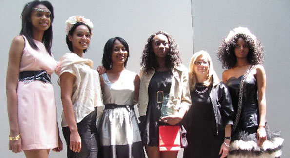 Adegbemisola Ademisoye poses with models decked out in her designs.