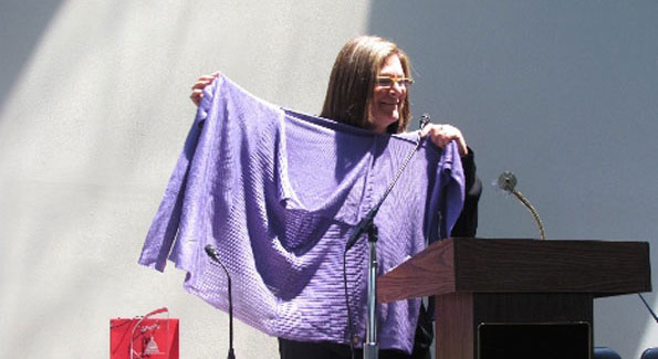 Fern Mallis poses with a sweater given to her by one of the designers.