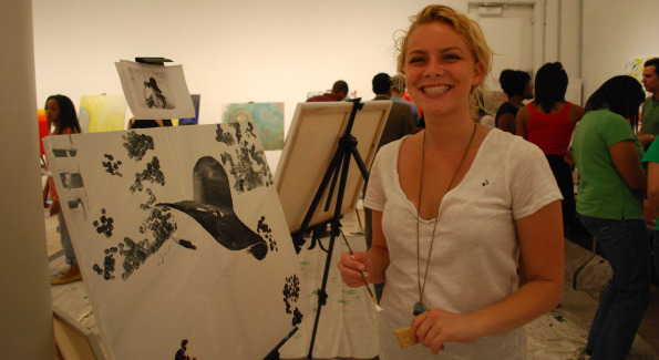 ArtJammer Christine Pfeil next to her work of art.  Photo by Roshan Farazad.