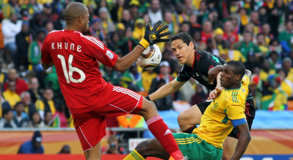 South African Itumeleng Khune (pictured right) blocks shot from Guillermo Franco, (pictured center), of Mexico. Courtesy of Getty images.