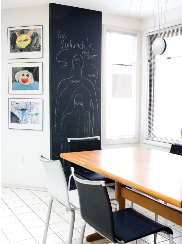 Framing their children's artwork and including  a chalkboard height chart adds more than a  touch of whimsy to the family's dining area. (Photo by John Heale)