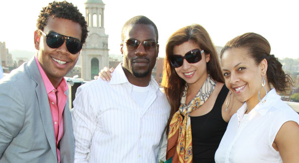 """Johnathan Burns, Ulrick Casseus, Samantha Taylor, and Jyl Woolfolk at the WL kick-off to Summer at the Donovan House rooftop, ADC """"Above DC"""" (Photo by Alfredo Flores)"""