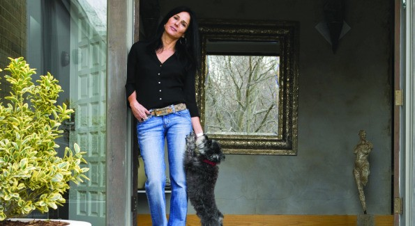 Architect Deborah Kalkstein with dog Hilton stand at the entryway of her modern Potomac, Md. home.  (photo by John Heale)