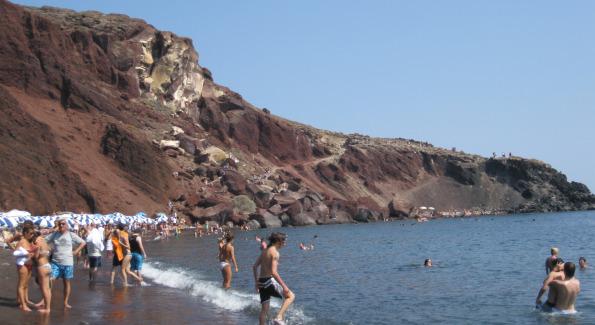 Outlook of Santorini's rocky Akrotiri beach marked by it's unique black san