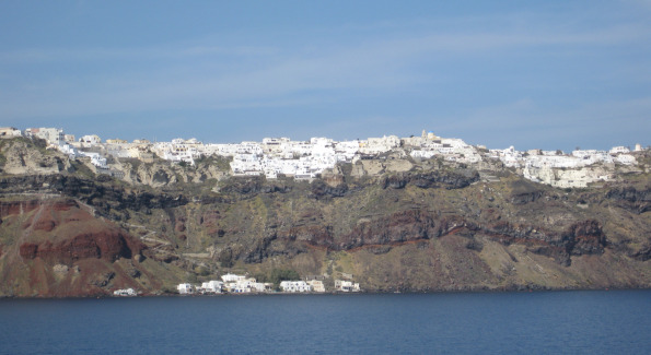 View of Santorini's White Villas from the Mediterranean