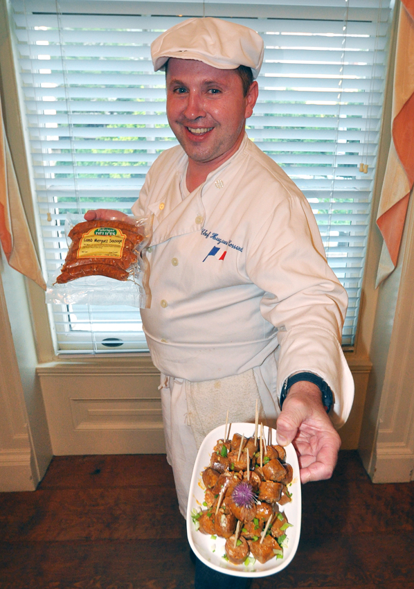 Food Expressions' Hugh Cossard displays a plate of traditional summer chipolata pork sausage