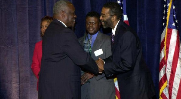 Mr. Wims is presented an award by Supreme Court Justice Clarence Thomas.