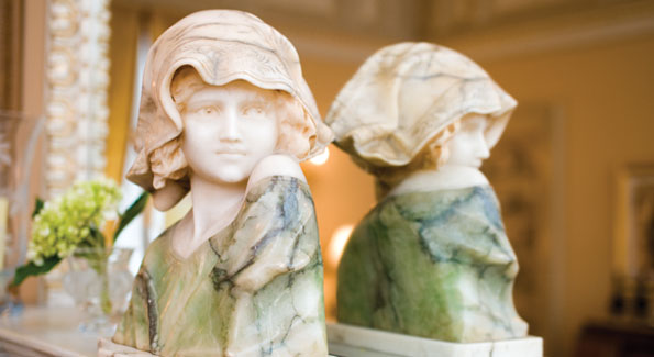 This 19th-century marble bust is reflected in detail on a mirrored mantlepiece. Photos by Joseph Allen.