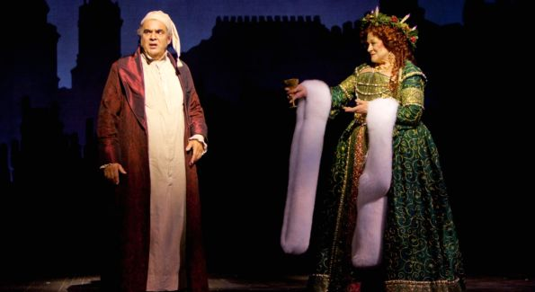 """Edward Gero as Ebenezer Scrooge and Anne Stone as the Ghost of Christmas Present in the 2009 Ford's Theatre production of Dickens's """"A Christmas Carol,"""" directed by Michael Baron. Photo by T. Charles Erickson."""