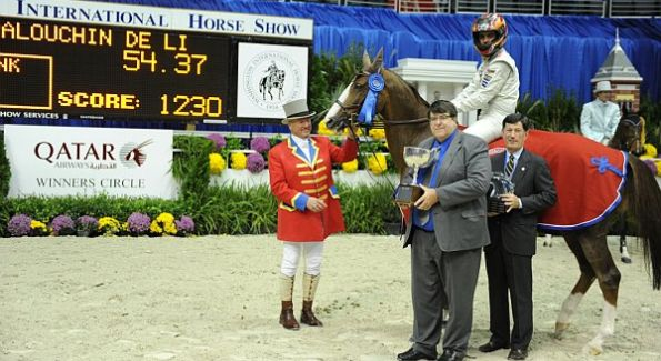 Rodrigo Pessoa and Palouchin de Ligny receive first prize at the Washington International Horse Show for the Gambler's Choice Costume Class from Tony Hughes (center) of Qatar Airways.  Also pictured are ringmaster, John Franzreb (left) and WIHS CEO, Eric L. Straus (right). Photo courtesy of Diana De Rosa.